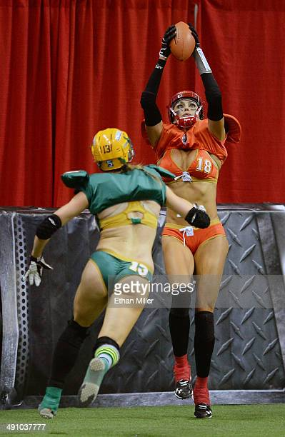 Cynthia Schmidt of the Las Vegas Sin catches a pass in the end zone for a touchdown against Anna Heasman of the Green Bay Chill during their game at...