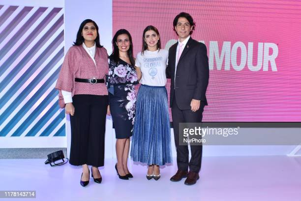 Cynthia Villarreal, Michelle Renaud, Mauricio Becker poses for photos during the pink carpet of 'Vive con Glamour' to promote prevention of breast...