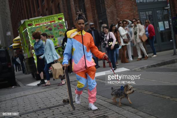 TOPSHOT Cynthia walks with her dog in Dumbo neighborhood in Brooklyn in New York City on April 29 2018