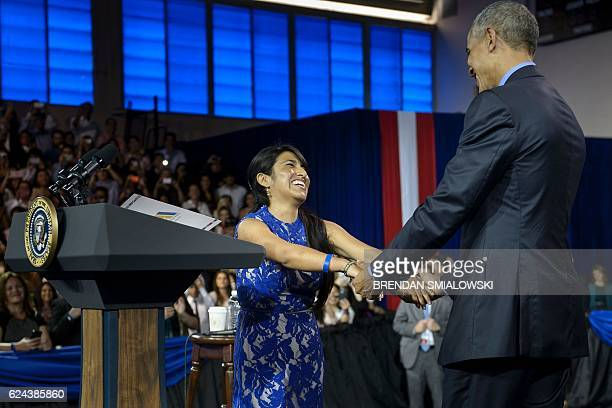 Cyntia Paytan greets US President Barack Obama after introducing him during a Young Leaders of the Americas Initiative townhall meeting at the...