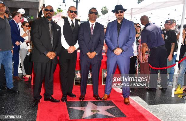 Cypress Hill's members Sen Dog DJ Muggs Eric Bobo and BReal pose at their just unveiled Hollywood Walk of Fame Star during a ceremony in Hollywood...