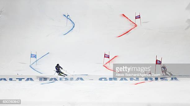 Cyprien Sarrazin of France Carlo Janka of Switzerland compete during the Audi FIS Alpine Ski World Cup Men's Parallel Giant Slalom on December 19...
