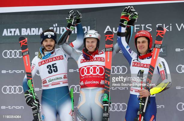 Cyprien Sarrazin of France takes 2nd place Henrik Kristoffersen of Norway takes 1st place Zan Kranjec of Slovenia takes 3rd place during the Audi FIS...