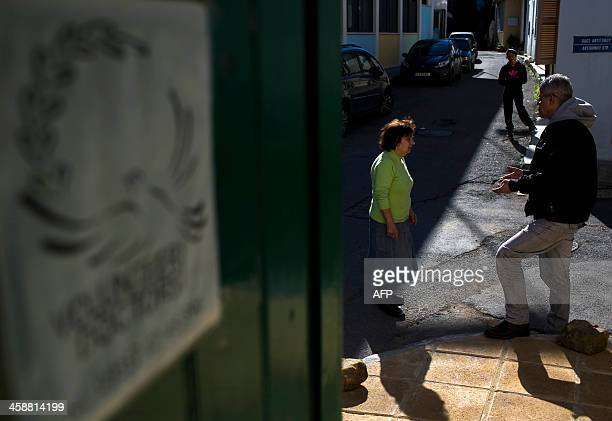 Cypriot doctor George Macriyiannis speaks with an elderly woman about her husband who was treated at the Volunteer Doctors of Cyprus clinic in...