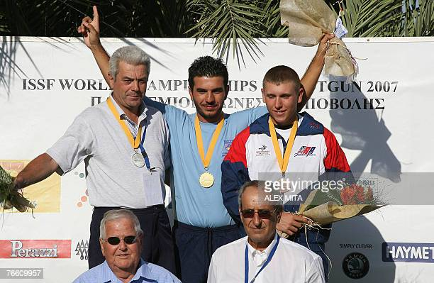 Cypriot George Achilleos celebrates on the podium after winning the gold medal in the men's skeet final of the ISSF World Shooting Championships in...