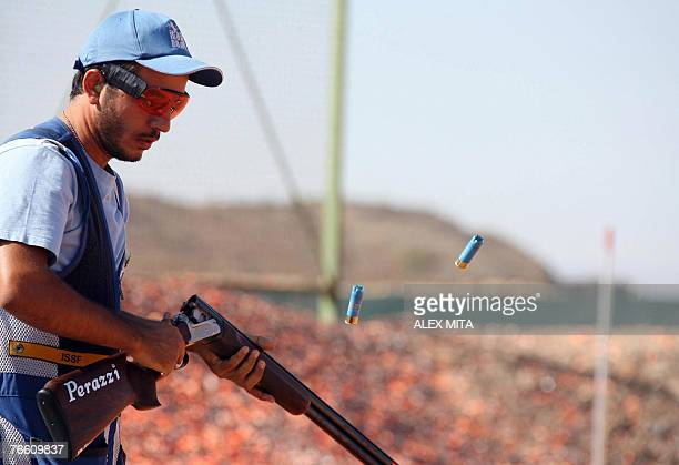 Cypriot George Achilleos discards his spent cartridges after shooting during the men's skeet final of the ISSF World Shooting Championships in...
