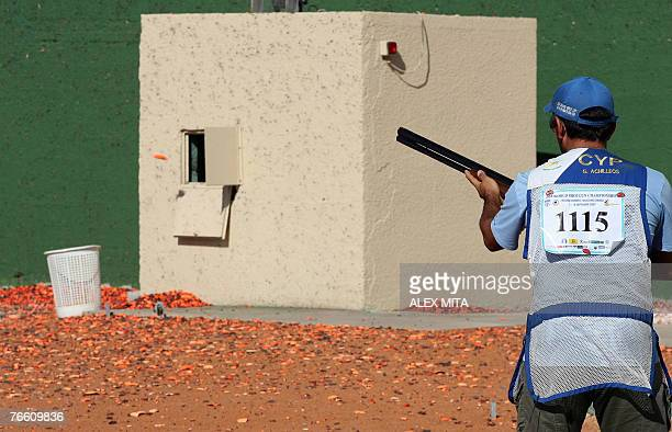 Cypriot George Achilleos eyes the target as he prepares to shoot during the men's skeet final of the ISSF World Shooting Championships in Nicosia 09...