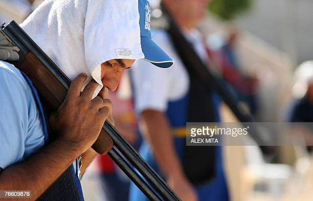 Cypriot George Achilleos prepares to shoot during the men's skeet final of the ISSF World Shooting Championships in Nicosia 09 September 2007...
