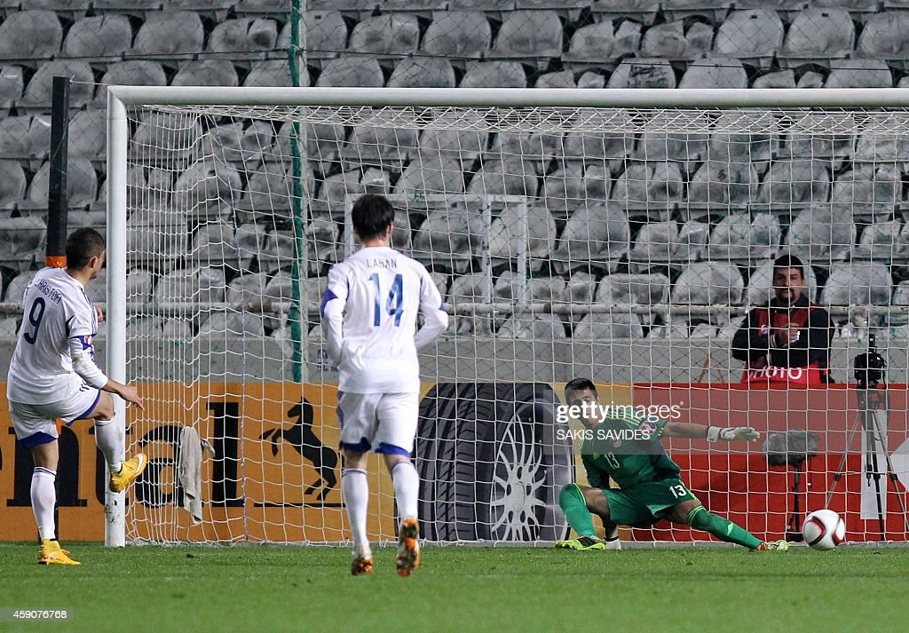 Cypriot player Dimitris Shristofi (L) scores a goal during their Euro 2016 Group B qualifying match against Andorra at the GSP Stadium in the capital Nicosia on November 16, 2014.