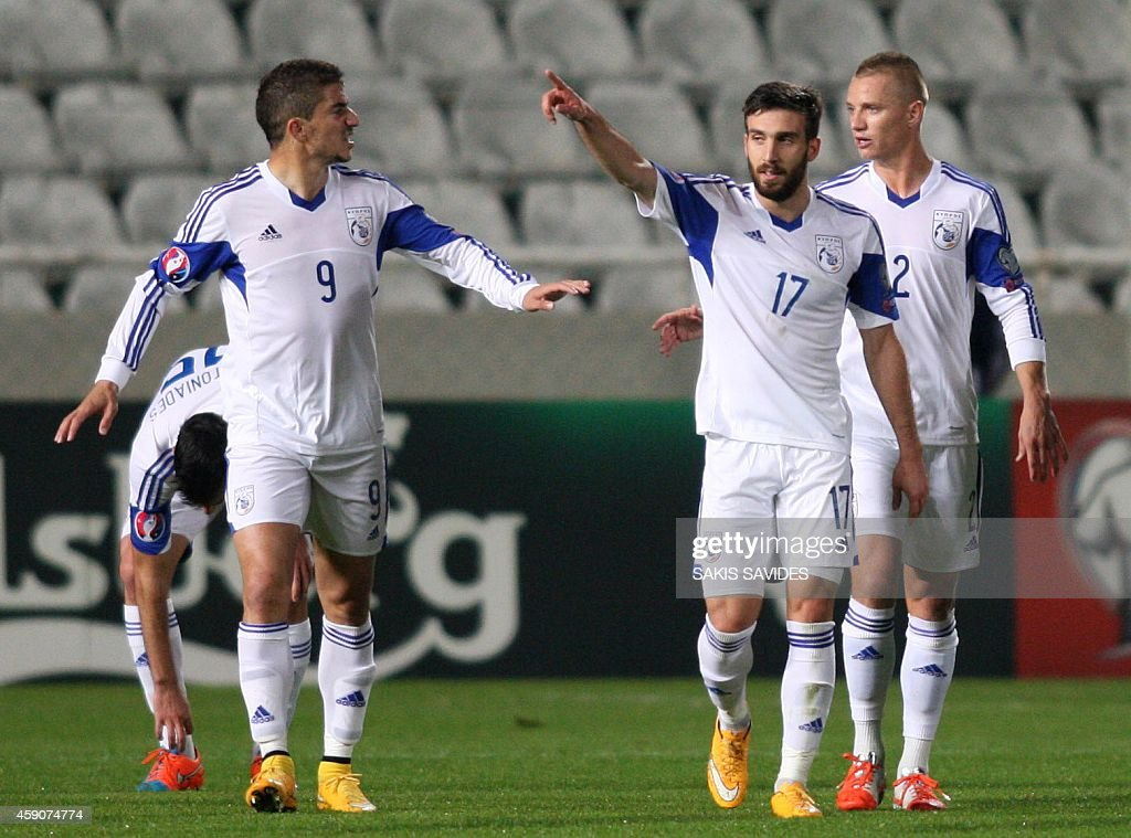 Cypriot player George Efrem (2R) celebrates scoring a goal with teammates during their Euro 2016 Group B qualifying match against Andorra at the GSP Stadium in the capital Nicosia on November 16, 2014.