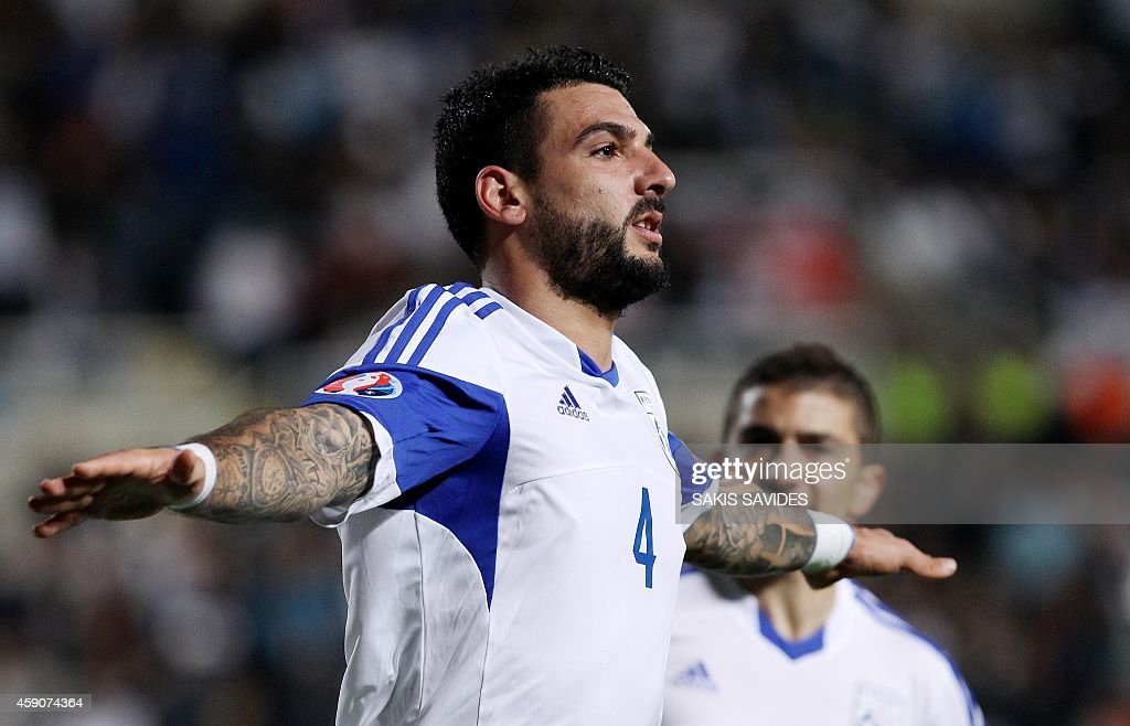 Cypriot player Giorgos Merkis celebrates scoring a goal during their Euro 2016 Group B qualifying match against Andorra at the GSP Stadium in the capital Nicosia on November 16, 2014.
