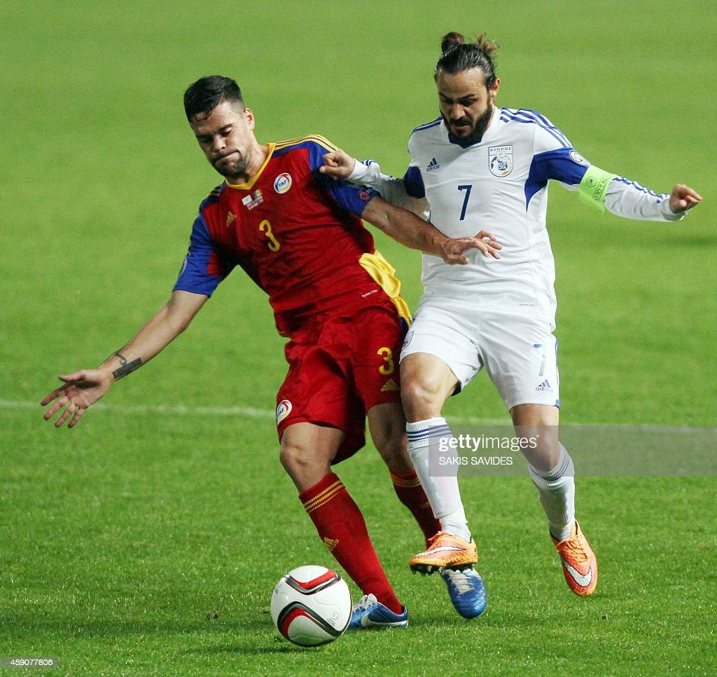 Cypriot player Stathis Aloneftis (R) fights for the ball with Andorra's Marc Vales during their Euro 2016 Group B qualifying match at the GSP Stadium in the capital Nicosia on November 16, 2014.