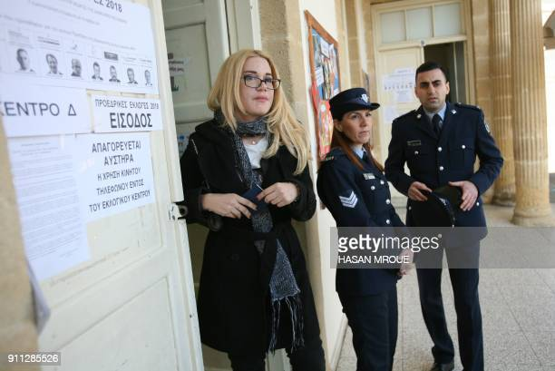 Cypriot police stand guard outside a polling station in the capital Nicosia on January 28 2018 Voters in Cyprus headed to the polls for a...