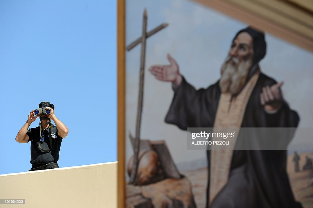 A Cypriot policeman looks through binoculars as he secures the area of Saint Maron elementary school in Nicosia on June 5, 2010 prior to the arrival of Pope Benedict XVI for a meeting with the small Catholic community on the second day of the pontiff's visit to the mainly Greek Orthodox Mediterranean island.