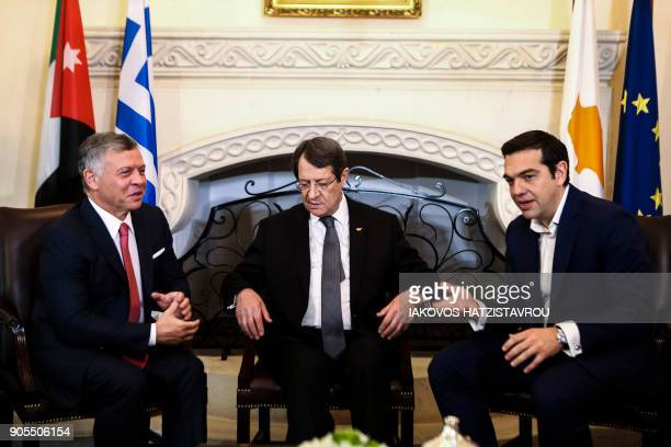 Cypriot President Nicos Anastasiades Greek Prime Minister Alexis Tsipras and Jordanian King Abdullah II attend a trilateral meeting in Nicosia on...