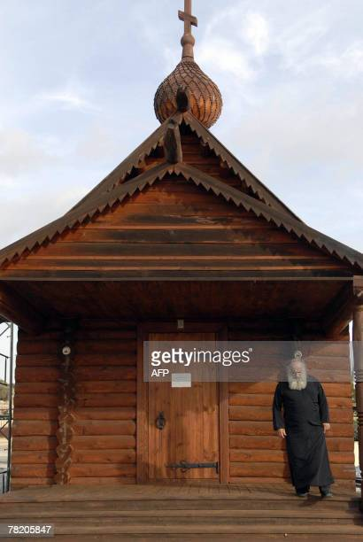 Cypriot priest Savvas Michaelides stands outside his humble church near the coastal town of Limassol 15 November 2007 Standing outside his church in...