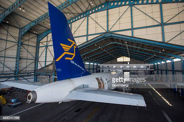 A Cyprus Airways Public Ltd operated Airbus A320 aircraft manufactured by Airbus Group NV stands in a hangar during routine servicing at Larnaca...