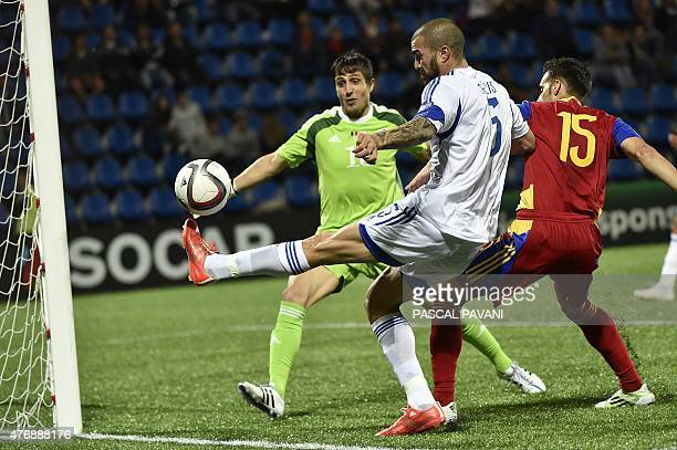 Cyprus defender Valentinos Sielis vies with Andorra's goalkeeper Ferran Pol and Andorra's defender Adrian Rodrigues during the Euro Cup 2016...