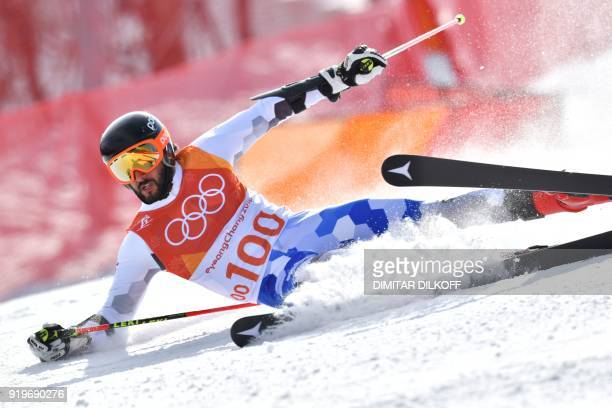 Cyprus' Dinos Lefkaritis falls while competing in the Men's Giant Slalom at the Jeongseon Alpine Center during the Pyeongchang 2018 Winter Olympic...