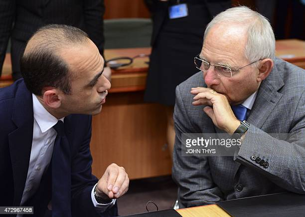 Cyprus Finance minister Harris Georgiadis talks with German Finance Minister Wolfgan Schaeuble before an Eurogroup Council meeting on May 11 2015 at...