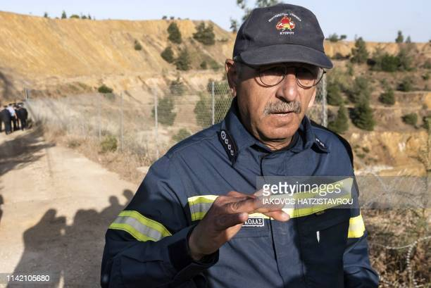 Cyprus fire chief Marcos Trangolas speaks at the acidic Red Lake near the village of Mitsero southwest of the capital Nicosia during the search for...