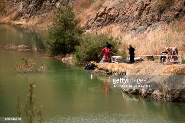 Cyprus forensic police search a suspected dump site in Memi Lake in the village of Xyliantos southwest of the capital Nicosia on April 26 2019...