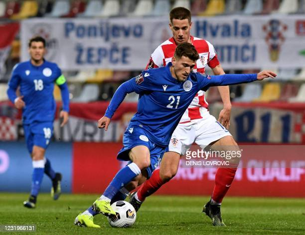 Cyprus' forward Marinos Tzionis fights for the ball with Croatia's midfielder Mario Pasalic during the FIFA World Cup Qatar 2022 qualification Group...