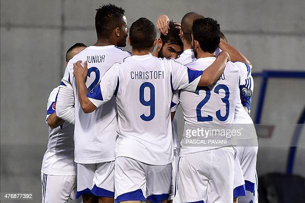Cyprus' forward Nestor Mytidis celebrates with teammates after scoring a goal during the group D Euro Cup 2016 qualifying football match between...