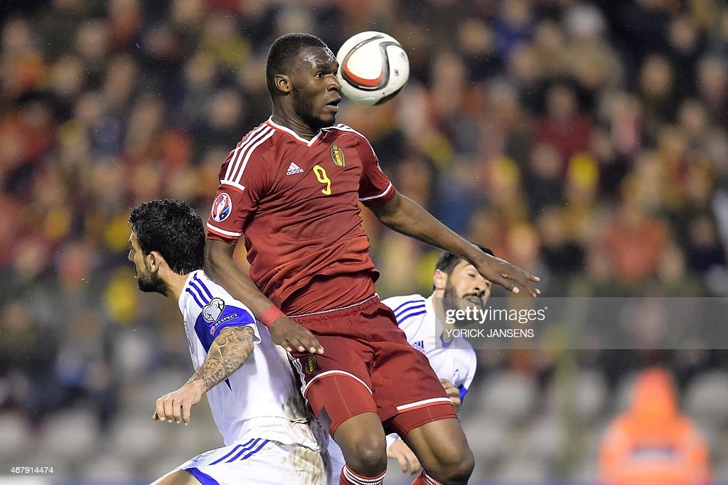 Cyprus' Giorgos Merkis (L) vies with Belgium's Christian Benteke during the Euro 2016 qualifying round football match between Belgium and Cyprus at the King Baudouin stadium in Brussels on March 28, 2015.