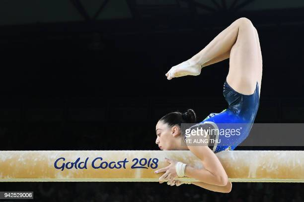 Cyprus' Gloria Philassides competes on the balance beam during the women's team final and individual qualification in the artistic gymnastics event...