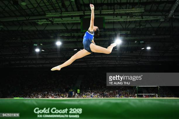 Cyprus' Gloria Philassides competes on the floor exercise during the women's team final and individual qualification in the artistic gymnastics event...