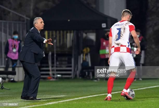 Cyprus' head coach Nikolaos Kostenoglou gestures during the FIFA World Cup Qatar 2022 qualification Group H football match between Croatia and Cyprus...