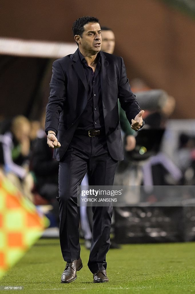 Cyprus' head coach Pambos Christodoulou reacts during the Euro 2016 qualifying round football match between Belgium and Cyprus at the King Baudouin stadium in Brussels on March 28, 2015.