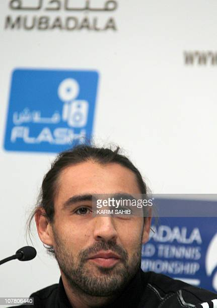 Cyprus' Marcos Baghdatis speaks during a press conference prior to the start of the 2011 Mubadala World Tennis Championship in Abu Dhabi on December...
