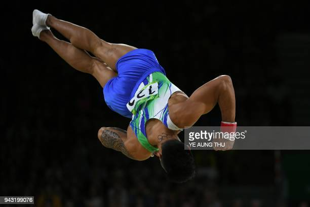 Cyprus' Marios Georgiou competes in the men's floor exercise final artistic gymnastics event during the 2018 Gold Coast Commonwealth Games at the...