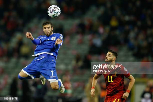 Cyprus' midfielder Georgios Efrem heads the ball past Belgium's midfielder Yannick Carrasco during the UEFA Euro 2020 qualification football match...