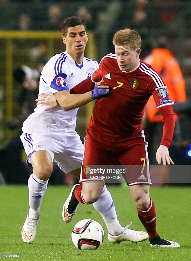 Cyprus' Pieros Sotiriou (L) vies with Belgium's Kevin De Bruyne during the Euro 2016 qualifying round football match between Belgium and Cyprus at the King Baudouin stadium in Brussels on March 28, 2015.