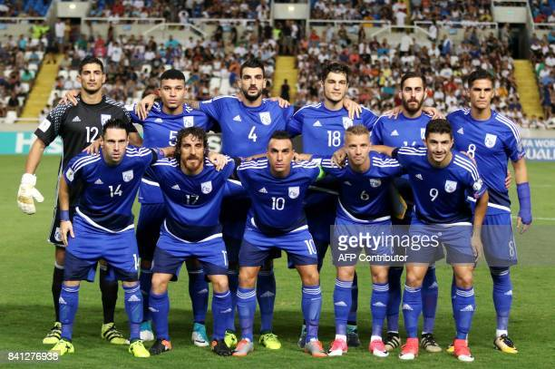 Cyprus' players pose for a family photo during their World Cup 2018 Europe qualifying match against Bosnia and Herzegovina at the GSP Stadium in...