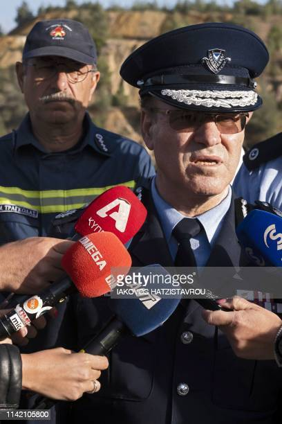 Cyprus police chief Kypros Michaelides speaks after visiting the acidic Red Lake near the village of Mitsero southwest of the capital Nicosia during...