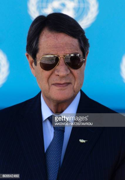 Cyprus President Nicos Anastasiades listens on during a press conference following a meeting with his Turkish-Cypriot counterpart and UN specialists...