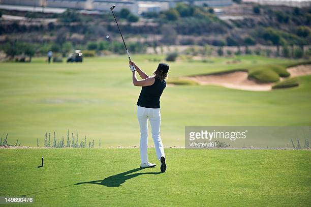 cyprus, woman playing golf on golf course - teeing off stock pictures, royalty-free photos & images