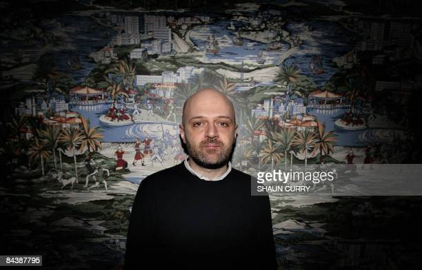 Cyprusborn contemporary fashion designer Hussein Chalayan poses for photographs at a press view of his exhibition 'From fashion and back' at The...