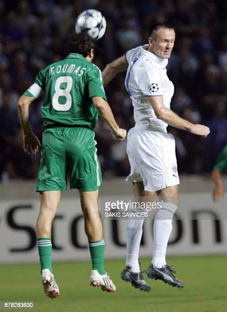 Cypruss Anorthosis Famagusta player Lukasz Sosin vies with Panathinaikos player Giannis Goumas during their UEFA Champions League Group B football...