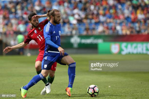 Cypruss midfielder Nektarios Alexandrou vies with Portugal's forward Bernardo Silva during the friendly football match Portugal vs Cyprus at Antonio...