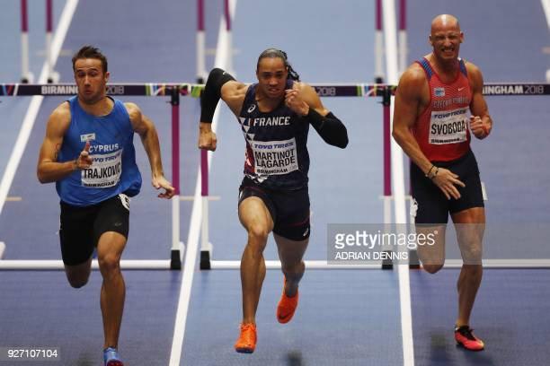 Cyprus's Milan Trajkovic France's Pascal MartinotLagarde and Czech Republic's Petr Svoboda compete in the men's 60m hurdles semifinals at the 2018...