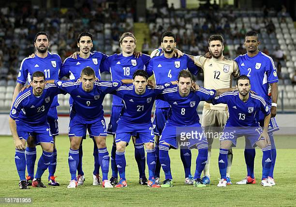 Cyprus's national football team poses for a photo before the start of their FIFA 2014 World Cup group E qualifying football match against Iceland in...