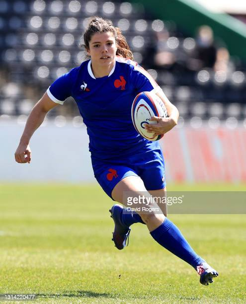 Cyrielle Banet of France runs with the ball during the Women's Six Nations match between England and France at Twickenham Stoop on April 24, 2021 in...