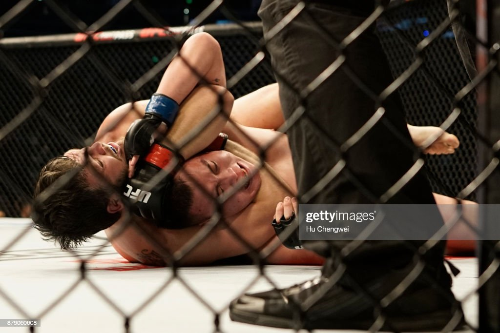 Cyril Asker fights with Hu Yaozong during the UFC Fight Night at Mercedes-Benz Arena on November 25, 2017 in Shanghai, China.