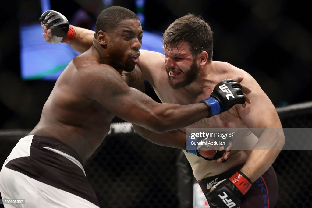 Cyril Asker of France (R) fights Walt Harris of United States (L) in the Heavyweight Bout during UFC Singapore Fight Night at Singapore Indoor Stadium on June 17, 2017 in Singapore.