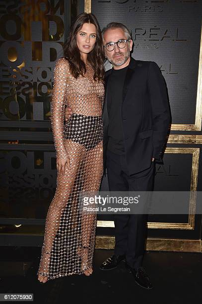 Cyril Chapuy and Bianca Balti attend the Gold Obsession Party L'Oreal Paris Photocall as part of the Paris Fashion Week Womenswear Spring/Summer 2017...